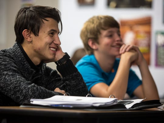 Azim Saidov, 18, sits with Robert Baldozck, 14, during a history class Thursday, Nov. 3, 2016 at Landmark Academy in Kimball Township.
