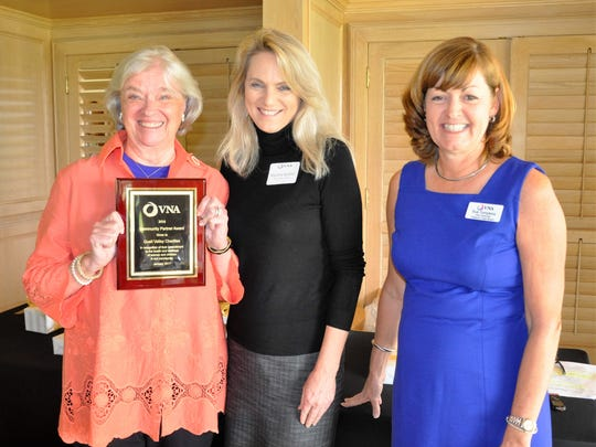 Wanda Lincoln and Martha Redner of Quail Valley Charities accept the Community Partner Award from Sue Tompkins.