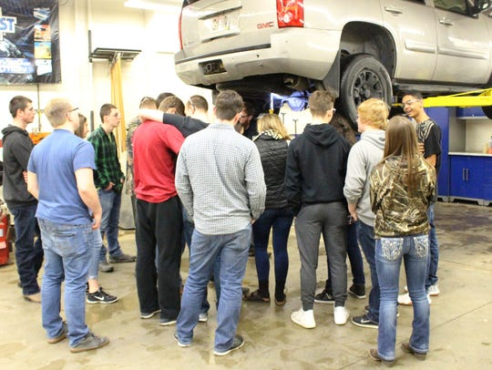Plymouth High School autos teacher Beau Biller teaches