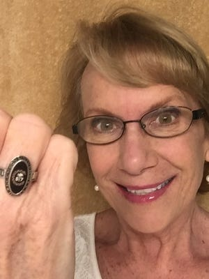Rhonda Hyde, 58, dons her Clemson University class ring. Though she earned her Ph.D. in 1987, she couldn't afford the ring when she graduated and waited 30 years to get it.