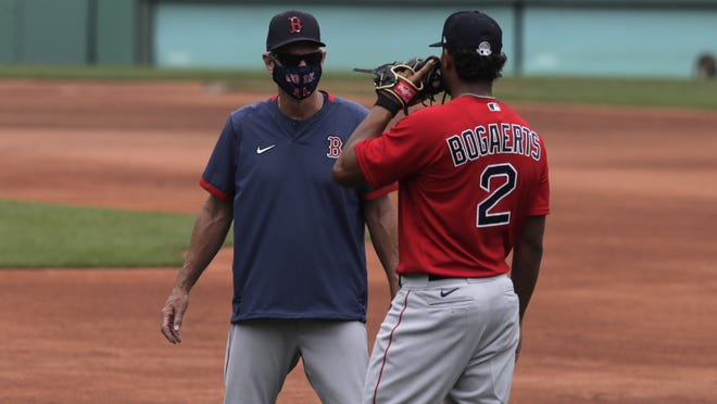 Red Sox manager Ron Roenicke (left) talks with shortstop Xander Bogaerts at Fenway Park on Thursday, July 9, 2020, in Boston.