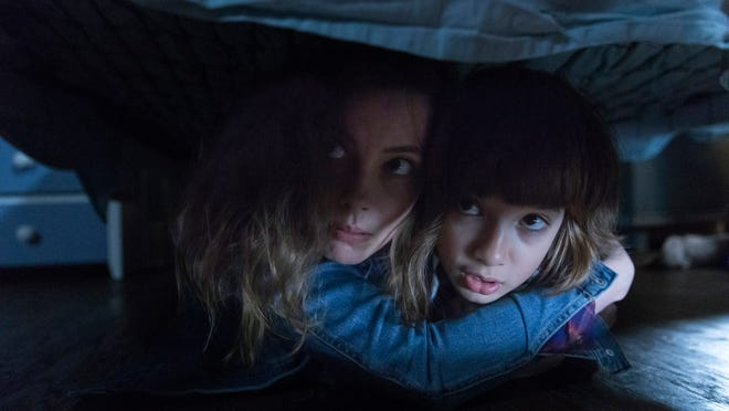 """Oliver and his mom (Azhy Robertson and Gillian Jacobs) find a """"safe"""" place to hide."""
