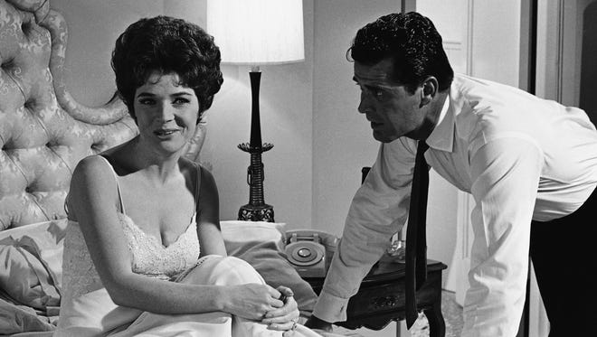 """In this July 18, 1963 photo, actress Polly Bergen and actor James Garner go through a scene during the filming of """"Move Over, Darling,"""" in the Hollywood section of Los Angeles. Bergen, an  Emmy-winning actress and singer died Saturday at her home in Southbury, Conn., publicist Judy Katz said. She was 84."""