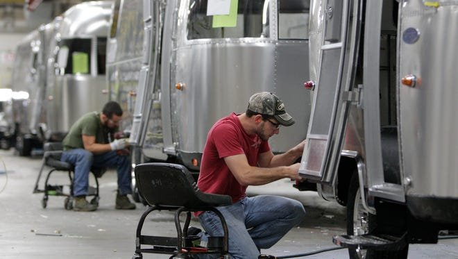 Jordan Peterson, of Bellefontaine, Ohio, works on an Airstream travel trailer at the Airstream factory. Not only are the Airstream trailers still being built by hand at the same western Ohio site that has produced them for the past 60 years, but the company also can't roll them out of there fast enough to meet demand