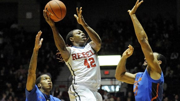 Mississippi guard Stefan Moody (42) shoots past Florida guard Kasey Hill (0) and forward Jon Horford (21) during the first half of an NCAA college basketball game in Oxford, Miss., Saturday, Jan. 24, 2015. (AP Photo/The Daily Mississippian, Thomas Graning)