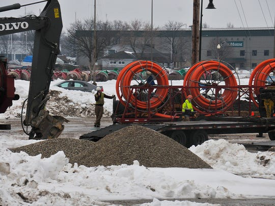 Workers for AT&T install utility lines within TID No. 4 on the west waterfront of Sturgeon Bay
