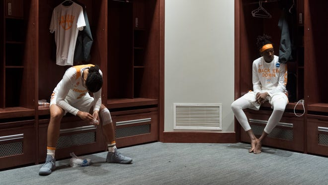 Tennessee's Evina Westbrook, left, and Rennia Davis sit at their lockers after the 66-59 loss to Oregon State on Sunday.