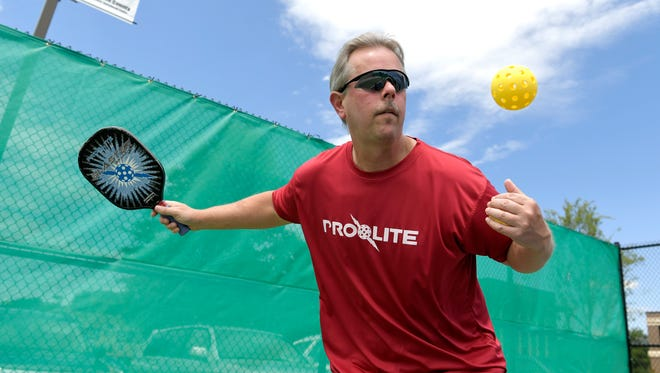 Jeff Carlson of Thompson Station won a gold metal in pickleball mens doubles, ages division 50-54 at the 2017 National Senior Games in Birmingham.   Carlson practices serving at Williamson County'a new outdoor pickelball courts in Franklin on Monday , June 26,2017.
