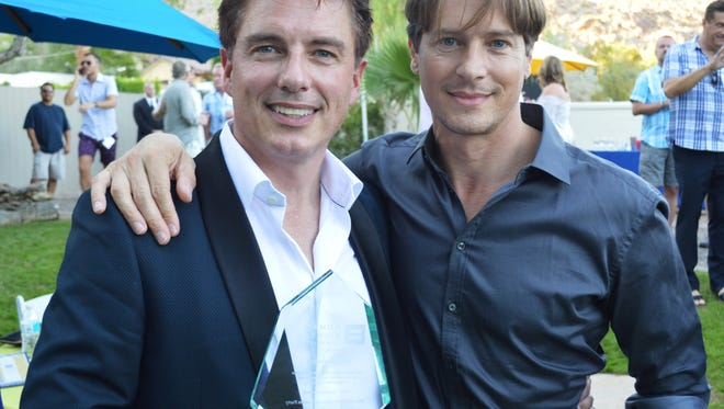 John Barrowman, with his husband Scott Gill, is holding his Visibility Award from the Human Rights Campaign during a Garden party at the Barry Manilow estate.  (Nov. 5, 2016)
