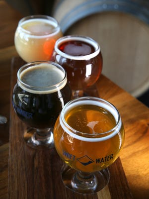 A beer flight at Swiftwater Brewing Co.  Pictured from bottom to top are the Mango Jalapeño Sour, Elizabeth Petrovna Russian Imperial Stout, Barrel Aged Barleywine and NYS Pale Ale.