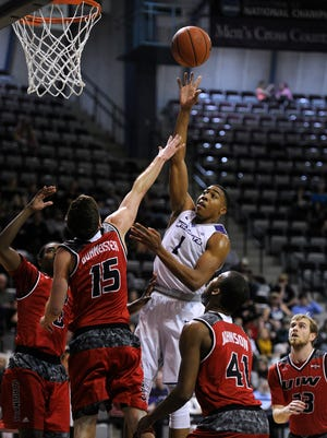 Abilene Christian's Jaren Lewis (1) puts up a shot over Incarnate Word defenders during the first half of the Wildcats' loss on Wednesday, March 1, 2017, at ACU's Moody Coliseum.