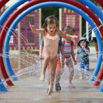 Lily Leach, 3, of Brandon, hops through a spray of cool water while playing at the Shiloh Splash Pad in Brandon on Wednesday. The splash pad is open Monday through Saturday, 10-6, and Sunday from 1-6.  Admission is $5 per person.  Children under 1 and adults over 51 and over are admitted for free.