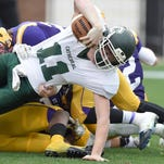 In this file photo, Cathedral quarterback Wyatt Booth struggles for additional yardage against St. Aloysius in the MHSAA Class 1A state championship game on Friday, December 5, 2014, at Davis Wade Stadium in Starkville.