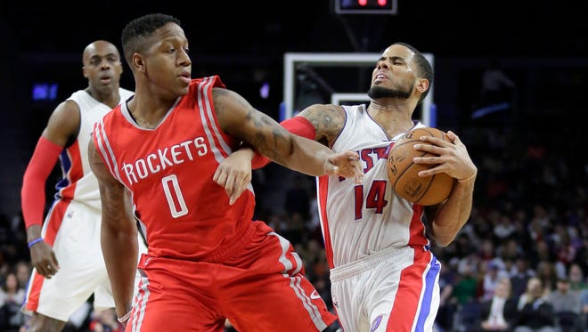 Detroit Pistons' D.J. Augustin tries to fend off Houston Rockets' Isaiah Canaan while driving to the basket Saturday.