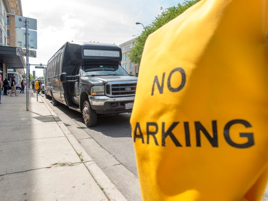 "Yellow ""No Parking"" bags cover parking meters as workers load gear into Vinyl Music Hall along Garden Street in Pensacola on April 11, 2017."