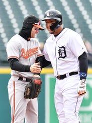 Tigers slugger Miguel Cabrera smiles with Orioles right