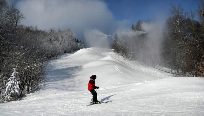 A skier sliding past the closed black-diamond Upper Limelight trail, where snow was being made in the Jackson Gore area at Okemo on Dec. 11.