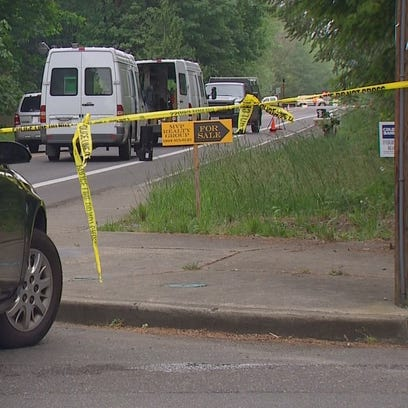 Police investigate after two men were shot on May 21,