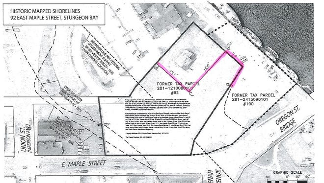 The pink line marks the boundary of the ordinary high water mark for parcel 92 along the proposed waterfront development site.