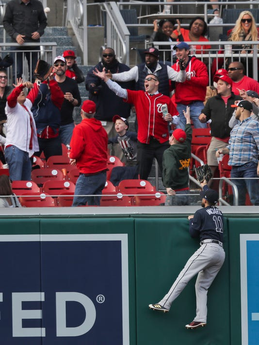 Atlanta Braves outfielder Ender Inciarte (11) leaps to watch a homerun hit by Washington Nationals Matt Adams, fall into the stands during the ninth inning of a baseball game at Nationals Park, Wednesday, April 11, 2018 in Washington. Atlanta won 5-3. (AP Photo/Pablo Martinez Monsivais)