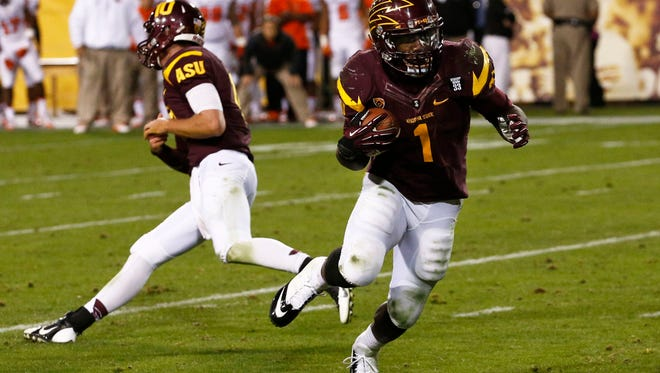 ASU's  Marion Grice takes the hand-off from quarterback Taylor Kelly against Oregon State in the quarter at Sun Devil Stadium on Saturday, Nov. 16, 2013 in Tempe, AZ.