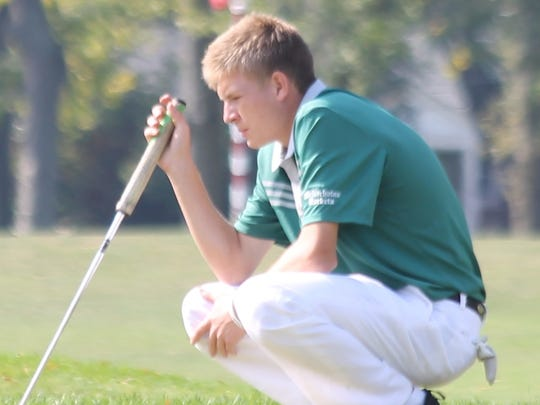 Rocket senior Cam Massa lines up a putt on No. 9.