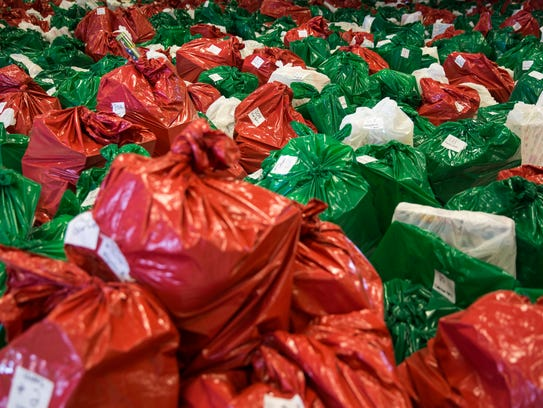 Hundreds of toy-filled bags sit sorted and organized