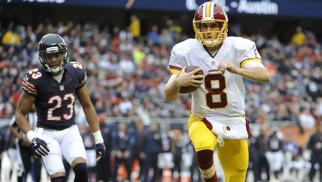 Kirk Cousins of Washington scores a touchdown during the during the first quarter against Chicago on December 13, 2015.