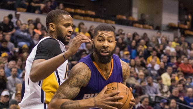 Jan 12, 2016: Phoenix Suns forward Markieff Morris (11) looks to shoot the ball while Indiana Pacers forward C.J. Miles (0) defends in the first half of the game at Bankers Life Fieldhouse. The Indiana Pacers beat the Phoenix Suns by the score of 116-97.