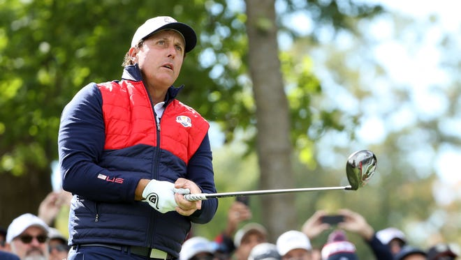 Phil Mickelson plays his shot from the sixth tee during a practice for the 41st Ryder Cup at Hazeltine National Golf Club on Sept. 27.