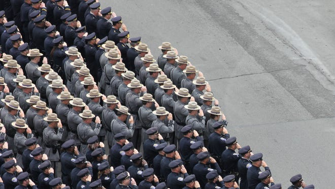A scene from the September 9, 2014 funeral for Rochester Police Officer Daryl Pierson, who was killed in the line of duty last year. State troopers join with other police officers outside the Blue Cross Arena at the War Memorial Wednesday, September 9, 2014.