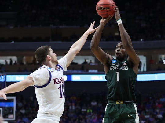 Michigan State freshman Joshua Langford shoots for three of his 10 points during the second half of Sunday's NCAA tournament loss in Tulsa, Okla.