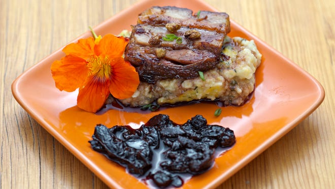 """Top Home Chef winner Darin Taverna's """"Braised and Confused"""" is Moroccan olive-and-agave-nectar-glazed pork belly with pickled and fried nasturtium seeds over herb polenta."""