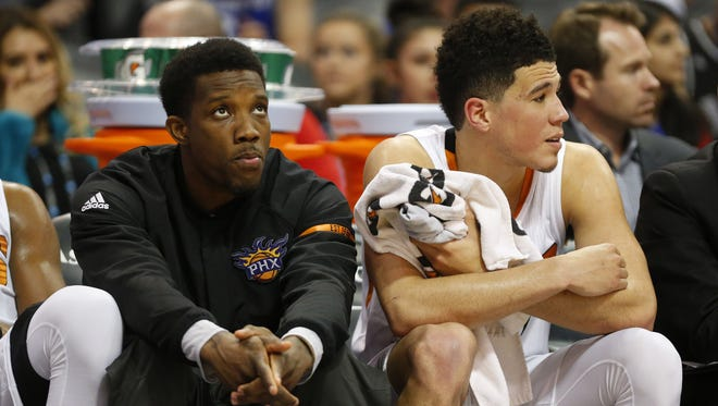 Suns guards Eric Bledsoe (left) and Devin Booker watch during a game against the Warriors at Talking Stick Resort Arena on April 5, 2017.