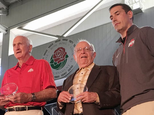 Earle Bruce, a former CSU and Ohio State football coach, is pictured between two other former Ohio State coaches, John Cooper, left, and Luke Fickell at a high school coaches clinic on April 15, 2016 in Columbus, Ohio.