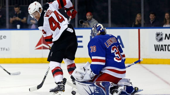 New Jersey Devils left wing Miles Wood (44) has his