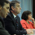 Marion County Clerk Beth White, right, Election Board Chairman Mark Sullivan, middle, and Vice Chairman Patrick Dietrick, left, listen to testimony during a September 2011 meeting. Matt Kryger / The Star