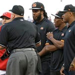 Bengals draft picks Will Clarke, Darqueze Dennard and Jeremy Hill stand at home plate as they help Reds manager Bryan Price, left, bring out the lineup card for Saturday's 11-2 loss to Colorado.