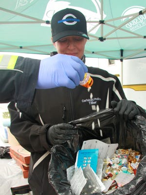 Carlsbad Police Department Evidence Technician Tonia Tiller collects a variety of prescription medications as part of National Drug Take Back Day in Carlsbad in 2017