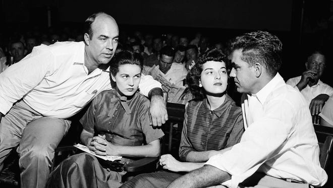 CORRECTS LOCATION TO MISSISSIPPI FROM MISSOURI - FILE - In this Sept. 23, 1955, file photo. J.W. Milam, left, and Roy Bryant, right, sit with their wives in a courtroom in Sumner, Miss. Milam and Bryant were acquitted of murder in the slaying of Emmett Till. Wheeler Parker and Deborah Watts, cousins of Till, said authorities should take a fresh look at the killing of Till since Carolyn Donham, then wife of Roy Bryant, who was at the center of the case, is now quoted as saying she lied in a new book. (AP Photo/File)