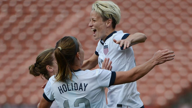 United States mdfielder Megan Rapinoe is congratulated by midfielder Lauren Holiday after scoring a goal against New Zealand during the first half at Candlestick Park.