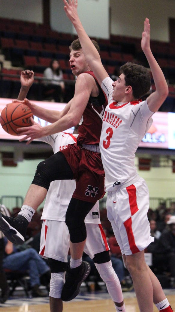 Nyack's Patrick Sickler is pressured by Hamilton's