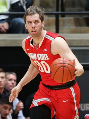 Jan 21, 2016: Ohio State Buckeyes forward Mickey Mitchell (00) brings the ball up court against the Purdue Boilermakers at Mackey Arena.