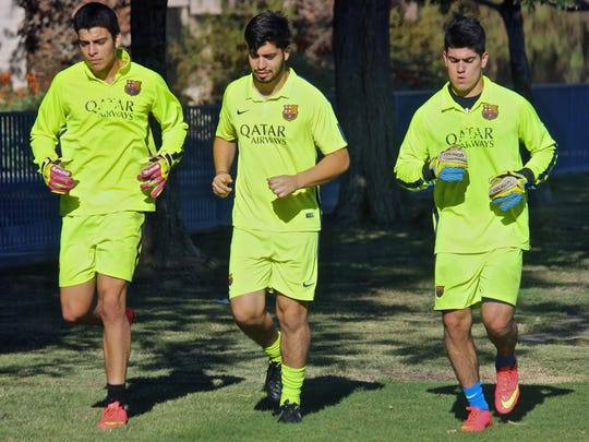 Uriel Lopez (left), his brother Carlos Lopez (center) and Daniel Rivera (right) jog together during a soccer training, Tuesday, at the Hovley Soccer Park in Palm Desert.