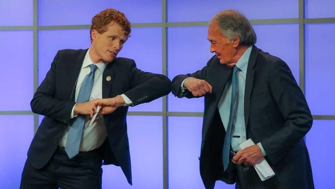 In this June 2020 file photo, Rep. Joe Kennedy III, left, elbow-bumps Sen. Edward Markey after their debate for the Democratic primary for senator from Massachusetts in Springfield. On Tuesday, Kennedy and Markey took their campaigns to Suffolk County Jail to talk to inmates about criminal justice.