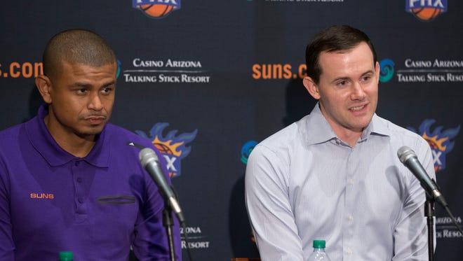Suns' Ryan McDonough speaks about the draft picks sitting next to head coach Earl Watson during a news conference at Talking Stick Resort Arena on Thursday, June 23, 2016 in Phoenix.