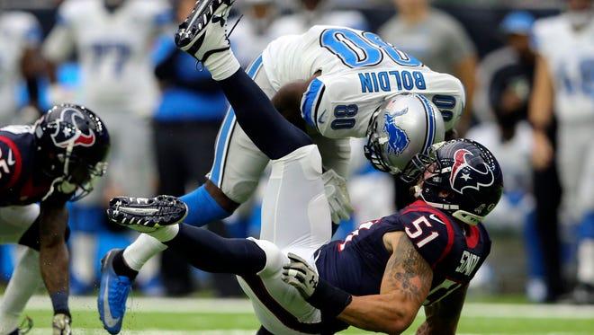 Oct 30, 2016; Houston, TX, USA;  Houston Texans outside linebacker John Simon tackles Detroit Lions receiver Anquan Boldin during the first quarter at NRG Stadium.