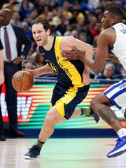 Indiana Pacers forward Bojan Bogdanovic (44) drives on Golden State Warriors forward Kevon Looney (5) in the first half of their game at Bankers Life Fieldhouse on Thursday, April 5, 2018. The Indiana Pacers defeated the Golden State Warriors 126-106.