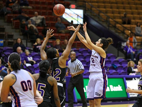 Lady Demons junior Shahd Abboud (12) attempts a shot against LSUA Saturday.