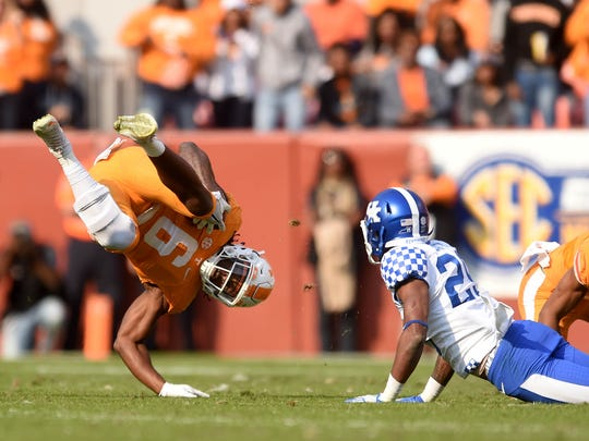 Tennessee running back Alvin Kamara (6) is tripped up by Kentucky corner back Derrick Baity (29) during the first half at Neyland Stadium on Saturday, Nov. 12, 2016.